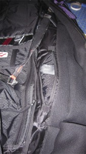 Rolled up harness bag in the new storage compartment