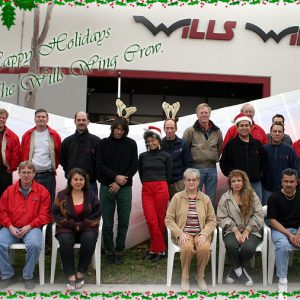 The Wills Wing Crew, 2003: Back row, standing, l-r: Ken Howells, Paul Diehl, Rich Collins, Mitch McAleer, Linda Meier, Steven Pearson, Mike Meier, Ruben Frausto, Rick Zimbelman, Martin Maldonado, Tom Blaty, Victor Sosa, Rob Kells. Front row, seated, l-r: Gene Atkins, Gary Smith, Eva Hanska, Martha Diorio, Narcisa Hartsch, Carlos Mendosa, Peter Swanson (not pictured: Chris Wills).